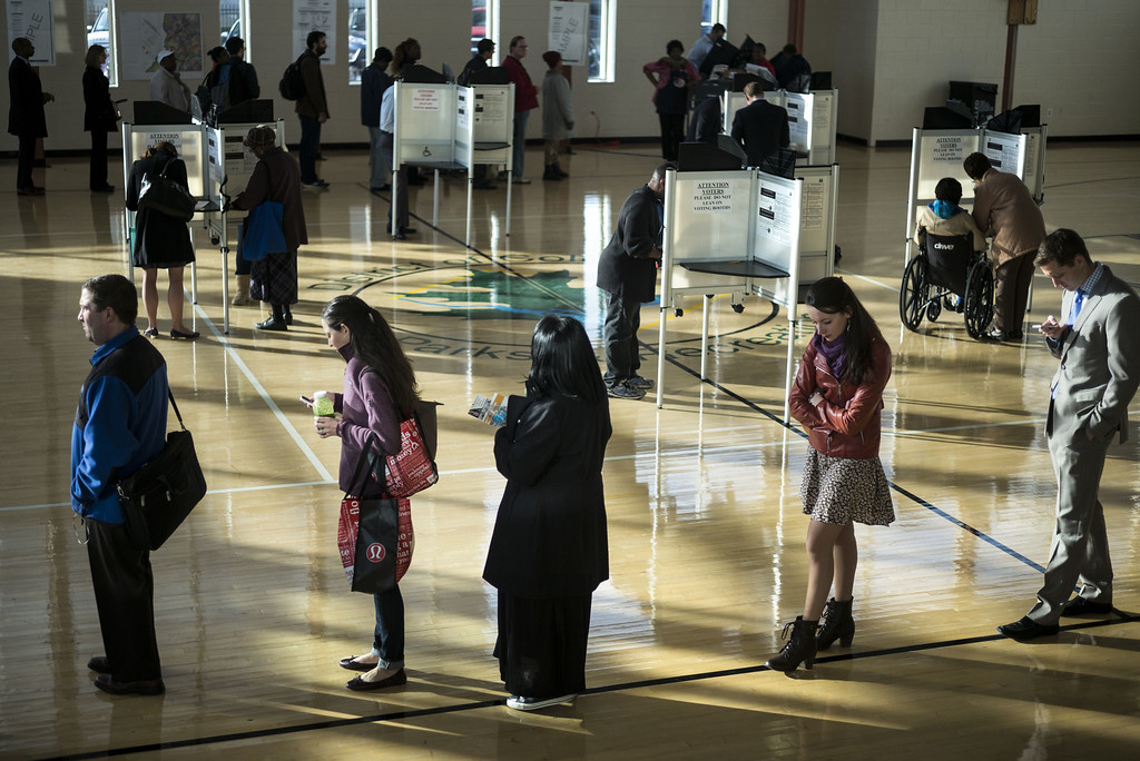 . Voters cast their ballots while others wait their turn at the Kennedy Recreation Center on November 4, 2014 in Washington, DC. Voters around the United States went to the poles to vote in the 2014 interim election. AFP PHOTO/Brendan SMIALOWSKI/AFP/Getty Images