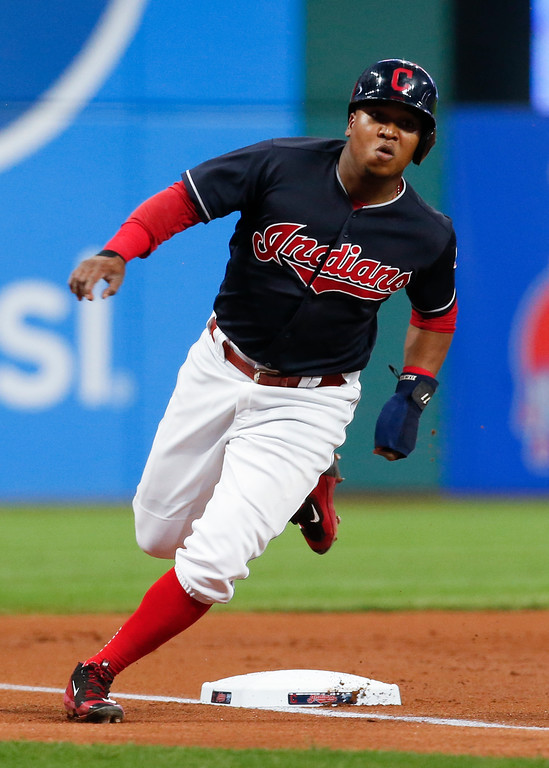 . Cleveland Indians\' Jose Ramirez rounds third base on the way to scoring on a single by Edwin Encarnacion during the first inning in a baseball game against the Minnesota Twins, Wednesday, Sept. 27, 2017, in Cleveland. (AP Photo/Ron Schwane)