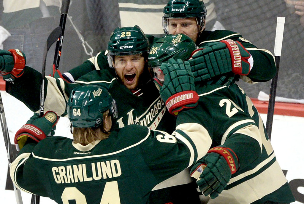 . Minnesota Wild players Mikael Granlund, Jason Pominville, Ryan Sutter and Mikko Koivu, celebrate Zach Parise\'s goal during the first period.  (Pioneer Press: Sherri LaRose-Chiglo)