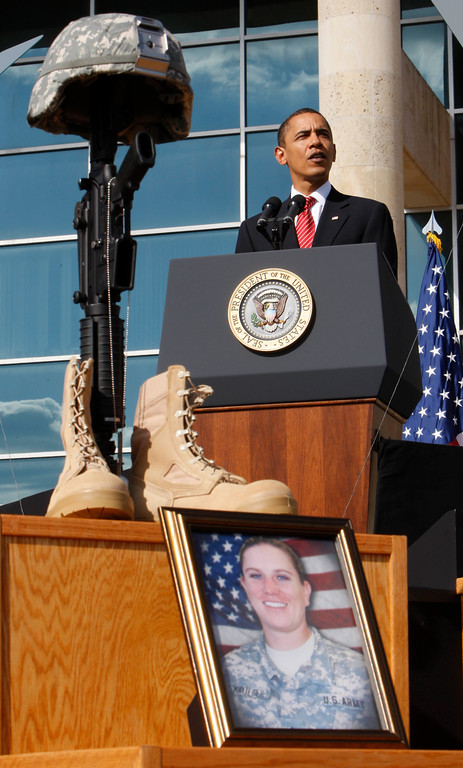 . President Barack Obama speaks at a memorial services at Fort Hood, Texas, Tuesday, Nov. 10, 2009. In the foreground is a photo of Sgt. Amy S. Krueger. (AP Photo/Pablo Martinez Monsivais)