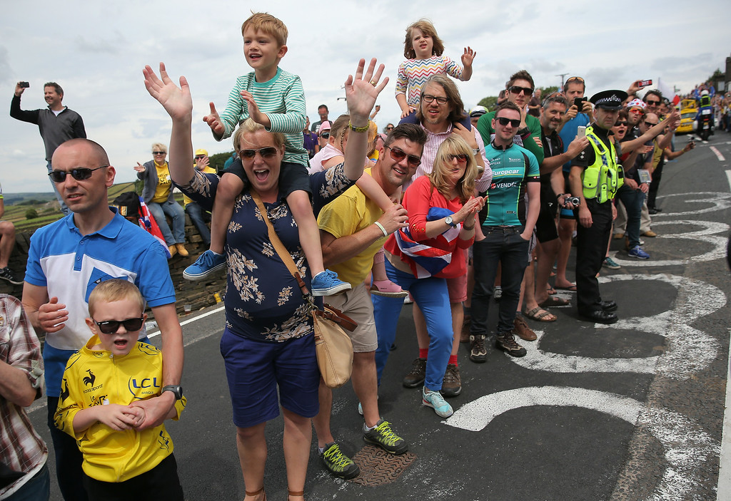 . SHEFFIELD, ENGLAND - JULY 06:  Fans crowd the sides of the course as they support the riders during stage two of the 2014 Le Tour de France from York to Sheffield on July 6, 2014 in Sheffield, United Kingdom.  (Photo by Doug Pensinger/Getty Images)