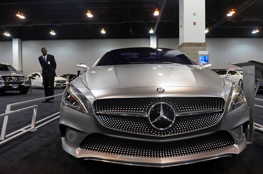 ". DENVER, CO- MARCH 19: Terrell Travis stands guard over the all new 2014 CLA 250 Mercedes-Benz.  The MSRP is $29,900 and will be available September 2013. The Denver Auto Show is scheduled to opens Wednesday so preparation for the show is in full swing on March 19, 2013.  The show, which is at the Denver Convention Center, will run through the weekend.  The auto industry is putting renewed emphasis on natural gas-powered vehicles. The low prices of natural gas makes them an attractive option, especially for fleet operators. But a dearth of fueling stations. Also of interest at the show is the new prevalence of luxury cars such as Mercedes offering  ""affordable luxury\' models such as the Mercedes-Benz CLA, starting at $29,900. (Photo By Helen H. Richardson/ The Denver Post)"