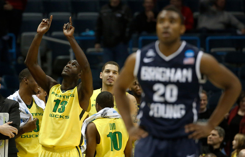 . Oregon forward Richard Amardi (13) points to the sky after Oregon defeated BYU 87-68 in a second-round game in the NCAA college basketball tournament Thursday, March 20, 2014, in Milwaukee. (AP Photo/Jeffrey Phelps)