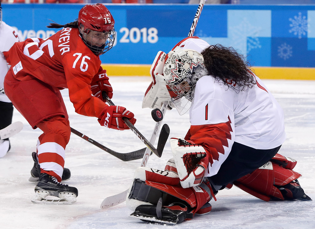 . goalie Shannon Szabados (1), of Canada, deflects a shot by Russian athlete Yekaterina Nikolayeva (76) during the second period of the semifinal round of the women\'s hockey game at the 2018 Winter Olympics in Gangneung, South Korea, Monday, Feb. 19, 2018. (AP Photo/Matt Slocum)