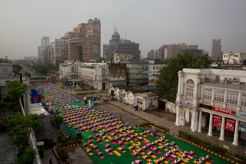 . Indians perform Yoga to mark the International Yoga Day in New Delhi, India, Wednesday, June 21, 2017. Millions of yoga enthusiasts across India take part in a mass yoga sessions to mark the third International Yoga Day which falls on June 21 every year. (AP Photo/Manish Swarup)