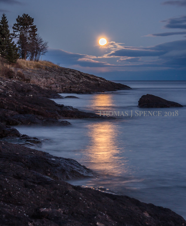 The Full Frost Moon rising over Lake Superior in Tofte, MN