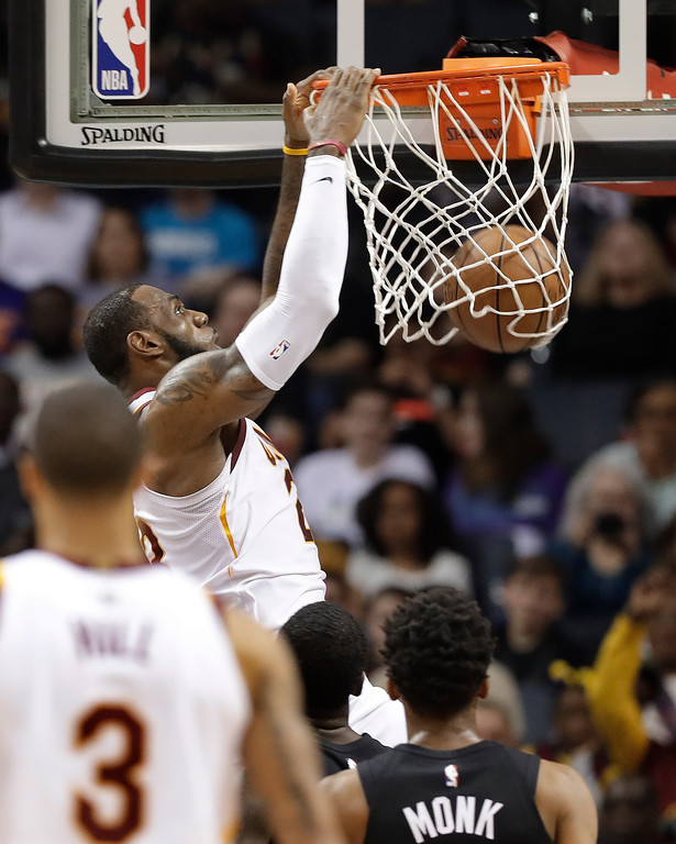 . Cleveland Cavaliers\' LeBron James dunks against the Charlotte Hornets during the first half of an NBA basketball game in Charlotte, N.C., Wednesday, March 28, 2018. (AP Photo/Chuck Burton)