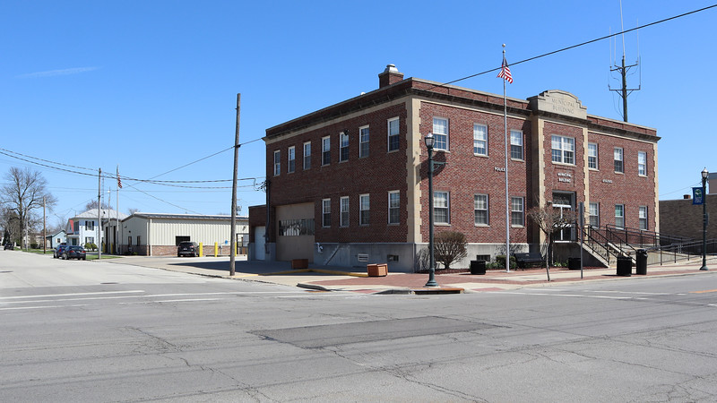 The Crawford Office building is the low building down the street from the brick Municipal Building.