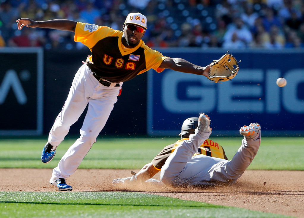 . World Team\'s Yoan Moncada, right,of the Boston Red Sox, steals second as U.S. Team\'s Travis Demeritte, of the Texas Rangers, cannot reach the throw during the third inning of the All-Star Futures baseball game, Sunday, July 10, 2016, in San Diego. (AP Photo/Lenny Ignelzi)