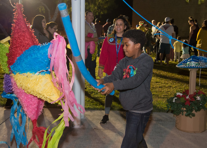 Khrystain Shelton (8) hits a pinata during the Islander Lights Celebration.