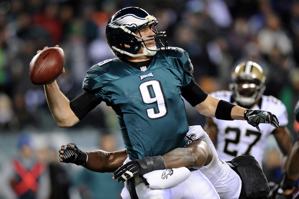 . PHILADELPHIA, PA - JANUARY 04:  Nick Foles #9 of the Philadelphia Eagles throws a pass against Curtis Lofton #50 of the New Orleans Saints during their NFC Wild Card Playoff game at Lincoln Financial Field on January 4, 2014 in Philadelphia, Pennsylvania.  (Photo by Maddie Meyer/Getty Images)