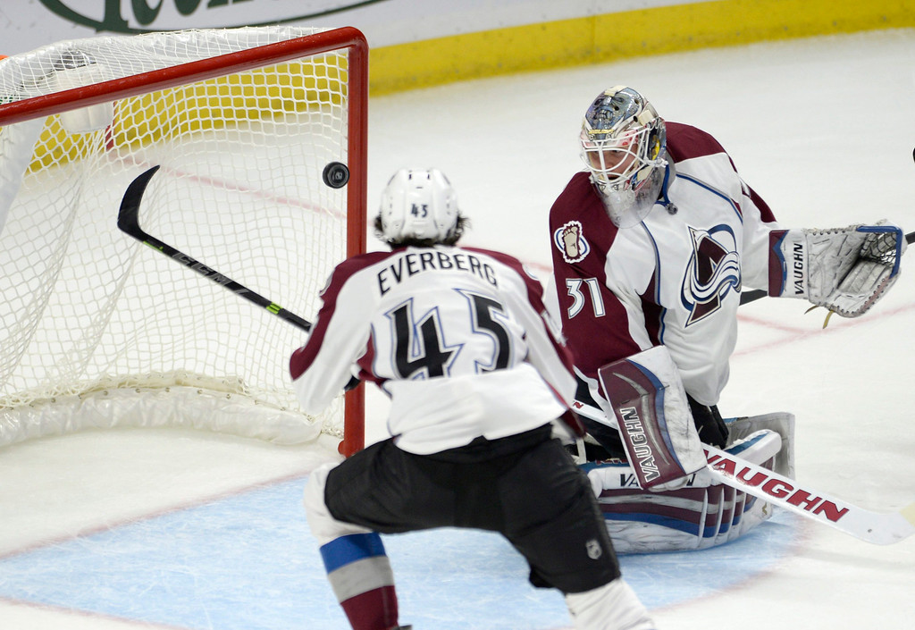 . Colorado Avalanche goaltender Calvin Picard and teammate Dennis Everberg (45) watch as a puck goes into the net for a goal by the Ottawa Senators during the first period of an NHL hockey game Thursday, Oct. 16, 2014, in Ottawa, Ontario. (AP Photo/The Canadian Press, Justin Tang)