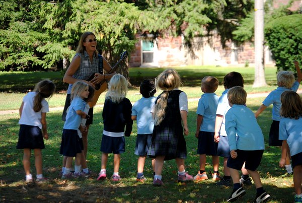 Kindergarten Students Dance on the Lawn