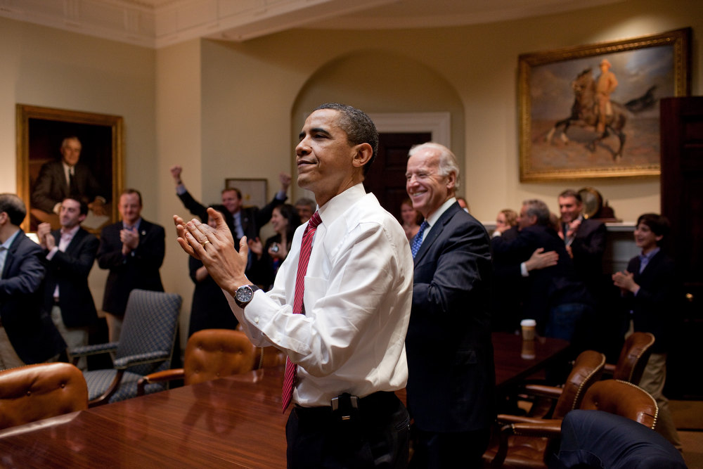 ". March 21, 2010 ""Watching the historic House vote on a television in the Roosevelt Room, the President and Vice President applauded after the bill passed. It was an emotional conclusion to an almost year-long battle to pass health care reform.\""  (Official White House Photo by Pete Souza)"