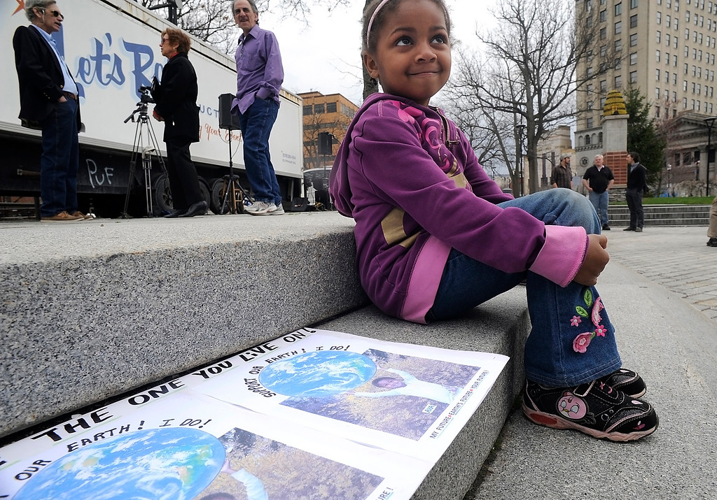 . Ava Simko, 5, sits by a sign she made for an Earth Day program on Public Square, Wilkes-Barre, Pa., Tuesday, April 22, 2014. (AP Photo/The Citizens\' Voice, Mark Moran)