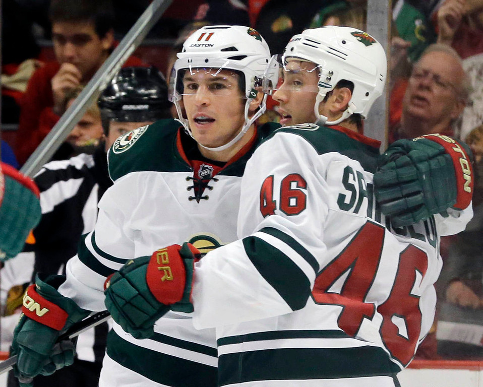 . Minnesota Wild\'s Zach Parise (11), left, celebrates with Jared Spurgeon (46) after scoring a goal during the first period of an NHL hockey game against the Chicago Blackhawks in Chicago, Saturday, Oct. 26, 2013. (AP Photo/Nam Y. Huh)