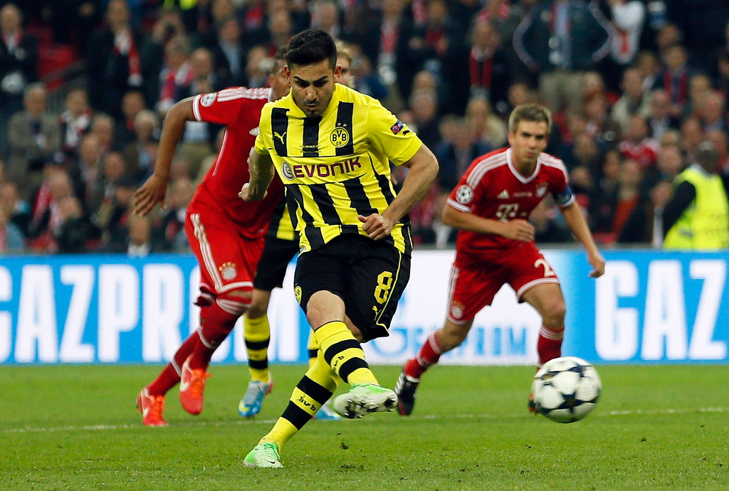 . Borussia Dortmund\'s Ilkay Guendogan scores a penalty goal against Bayern Munich during their Champions League final soccer match at Wembley stadium in London May 25, 2013.           REUTERS/Stefan Wermuth