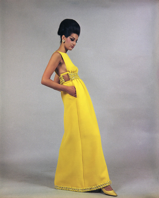 . A long evening dress of canary-yellow craped silk, trimmed with silver and yellow embroideries at the waistline and hem, a creation by the Heins W. Riva fashion house of Rome, July 12, 1968, to be presented at its show of fall and winter fashions on July 18. (AP Photo/Mario Torrisi)