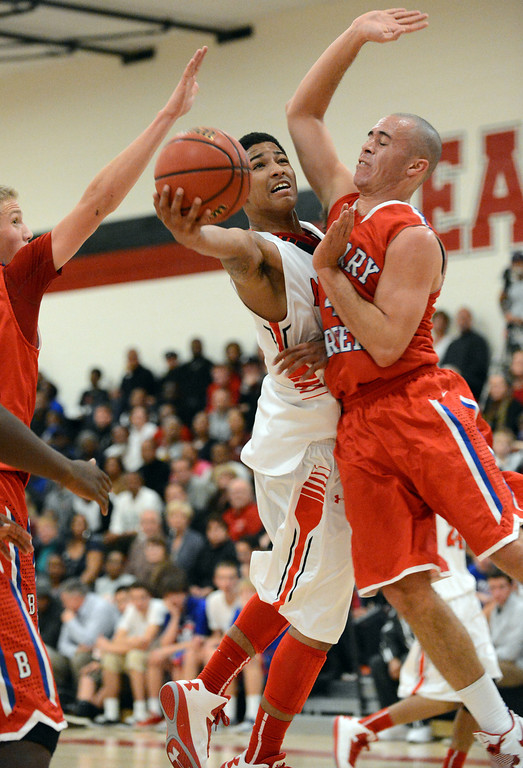 . East\'s Jevon Griffin, left, controls the ball against Cherry Creek\'s Sam Stoveall in the 1st half of the game at East High School on Friday, Nov. 30, 2012. Hyoung Chang, The Denver Post