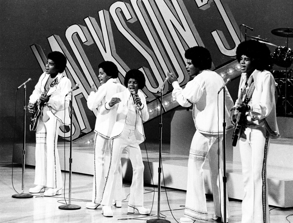 """. The Jackson 5 perform during the \""""Sonny and Cher Comedy Hour\"""" in Los Angeles, Calif., Sept. 15, 1972.  The brothers, from left to right, are, Tito; Marlon; lead singer Michael, the youngest; Jackie; and Jermaine.  (AP Photo)"""