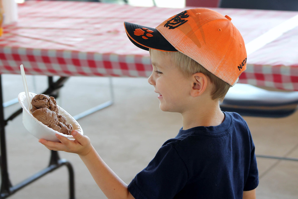 . Colin Conway of Meadeville, Pennsylvania, gets a bowl of ice at Lake Metroparks Farmpark\'s 2017 Ice Cream Weekend. This year\'s event is July 21-22. Discover where the sugar and various flavors for ice cream come from. Make ice cream crafts, take part in Farmpark�s regular daily activities and enjoy a bowl of Pierre�s ice cream at our outdoor sundae bar. For more information, visit lakemetroparks.com/events-activities/events/ice-cream-weekends. (Kristi Garabrandt/The News-Herald.)
