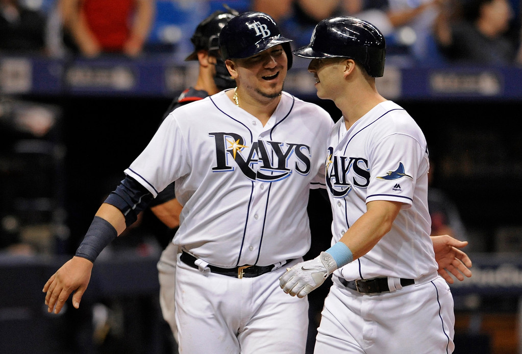 . Tampa Bay Rays\' Jesus Sucre congratulates Corey Dickerson, right, after Dickerson\'s three-run home run off Cleveland Indians reliever Nick Goody during the eighth inning of a baseball game Thursday, Aug. 10, 2017, in St. Petersburg, Fla. The Rays won 4-1. (AP Photo/Steve Nesius)