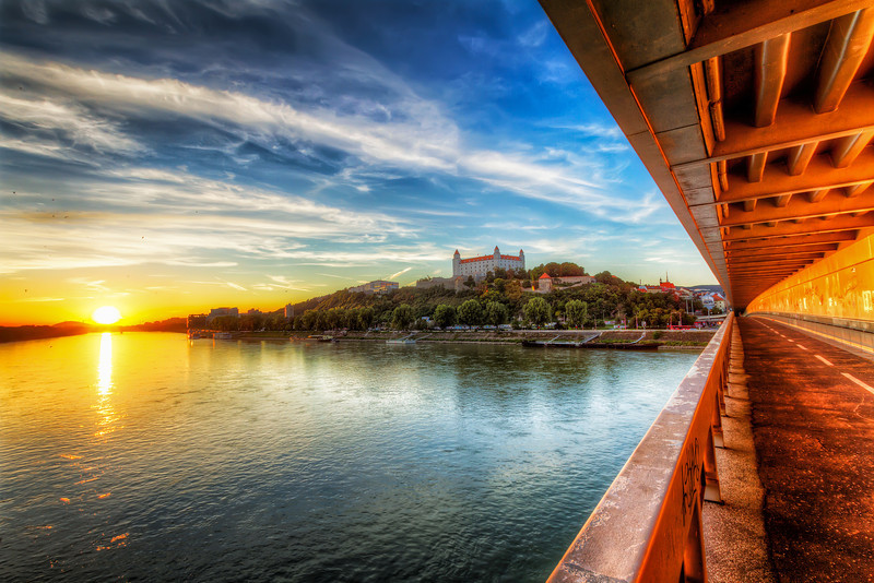 Sunset on the New Bridge As the sun sets in Bratislava, it always colors all the bridges over the Danube to the most beautiful orange colors.