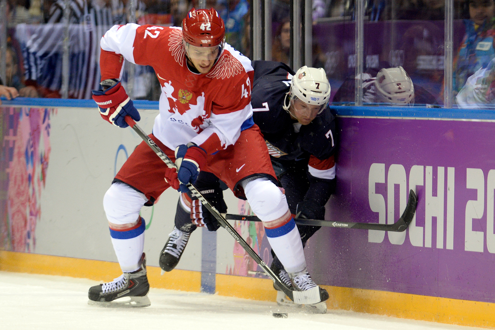 . Artyom Anisimov (42) of the Russia and Paul Martin (7) of the U.S.A. get physical during  the U.S.A.\'s shootout-win at Bolshoy arena. Sochi 2014 Winter Olympics on Saturday, February 15, 2014. (Photo by AAron Ontiveroz/The Denver Post)