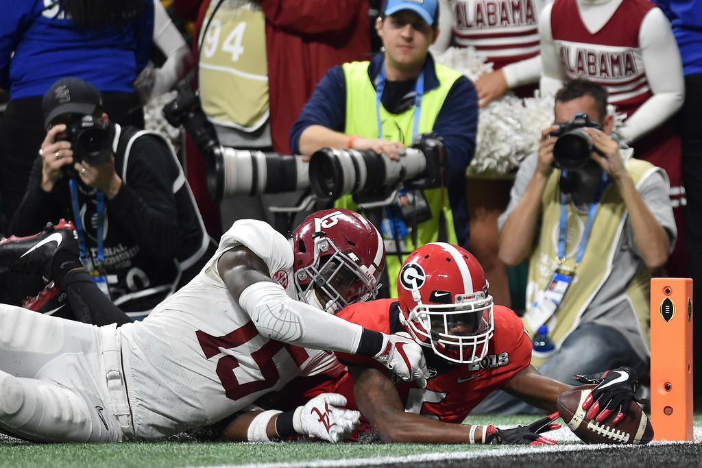 . Georgia wide receiver Terry Godwin (5) dives just short of the end zone under pressure from Alabama defensive back Ronnie Harrison (15)  in the NCAA college football playoff championship game in Atlanta on Monday, Jan. 8, 2018. (AJ Reynolds/Athens Banner-Herald via AP)