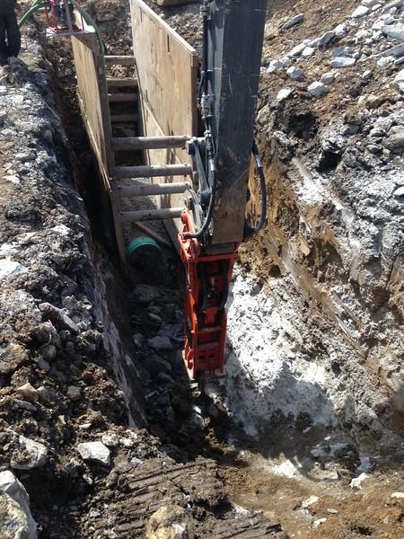 NPK GH18 hydraulic hammer on Deere 470 excavator.JPG