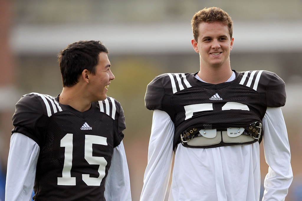. UCLA\'s Ka\'imi Fairbairn and Christopher Longo (l-r) share a laugh during practice April 9, 2014 in Westwood, CA.(Andy Holzman/Los Angeles Daily News)