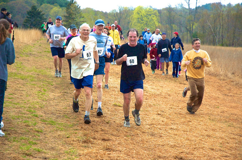 Leatherman's Loop founder Tony Godino (#63) finishes Loop in 2008 with friends Anton Deiters (#67) and Danny Martin (#60). Photo by Rob Cummings.