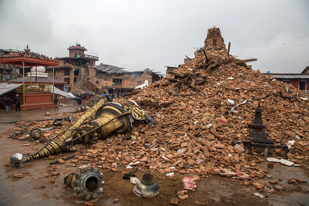 . Remains of the Karyabinayak temple lay on the ground after collapsing during the earthquake that hit Nepal on April 30, 2015 in Bungamati, Nepal. A major 7.8 earthquake hit Kathmandu mid-day on Saturday, and was followed by multiple aftershocks that triggered avalanches on Mt. Everest that buried mountain climbers in their base camps. Many houses, buildings and temples in the capital were destroyed during the earthquake, leaving over 5500 dead and many more trapped under the debris as emergency rescue workers attempt to clear debris and find survivors. Regular aftershocks have hampered recovery missions as locals, officials and aid workers attempt to recover bodies from the rubble.  (Photo by Omar Havana/Getty Images)