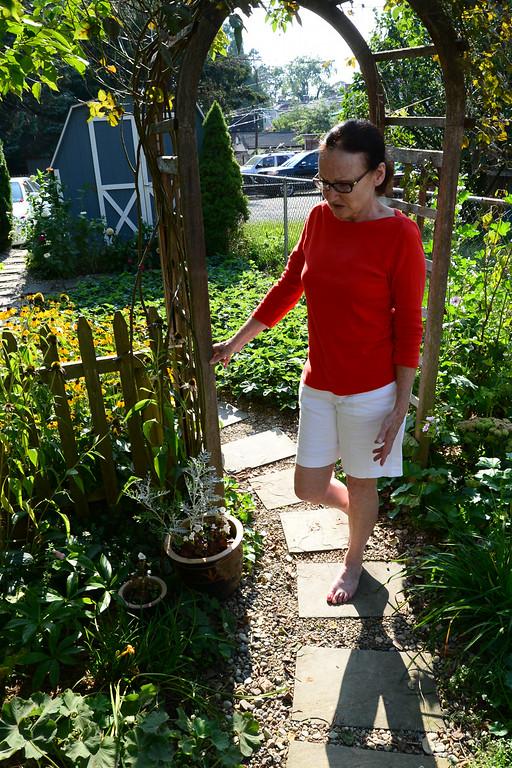 . PHOTO PETE BANNAN- Terry Spadoni in the garden of her West Chester row home.