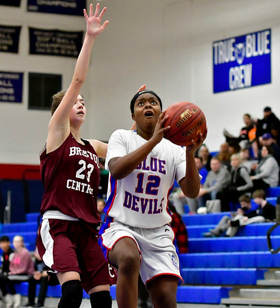 12/13/2018 Mike Orazzi | Staff Plainville High School's Kori Jones (12) and Bristol Central's Ella Watson (23) during Thursday night's basketball game at PHS.