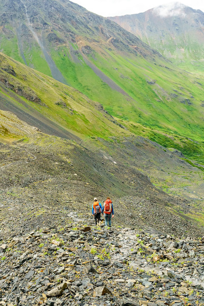 Tom Callahan and Abra Atwood descend into the Eagle River drainage from Crow Pass. Girdwood, Alaska.