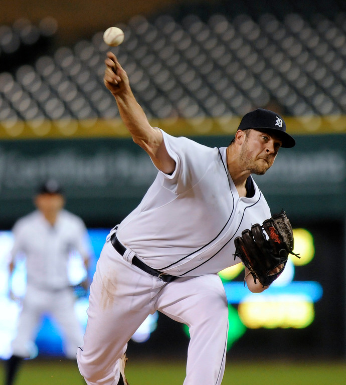 . Detroit Tigers pitcher Buck Farmer throws against the San Francisco Giants in the fifth inning of a baseball game Friday, Sept. 5, 2014, in Detroit. (AP Photo/Jose Juarez)