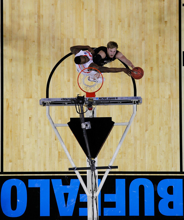 . Syracuse\'s Rakeem Christmas, left, blocks a shot by Western Michigan\'s Connar Tava (2) during the first half of a second-round game in the NCAA college basketball tournament in Buffalo, N.Y., Thursday, March 20, 2014. (AP Photo/Bill Wippert)