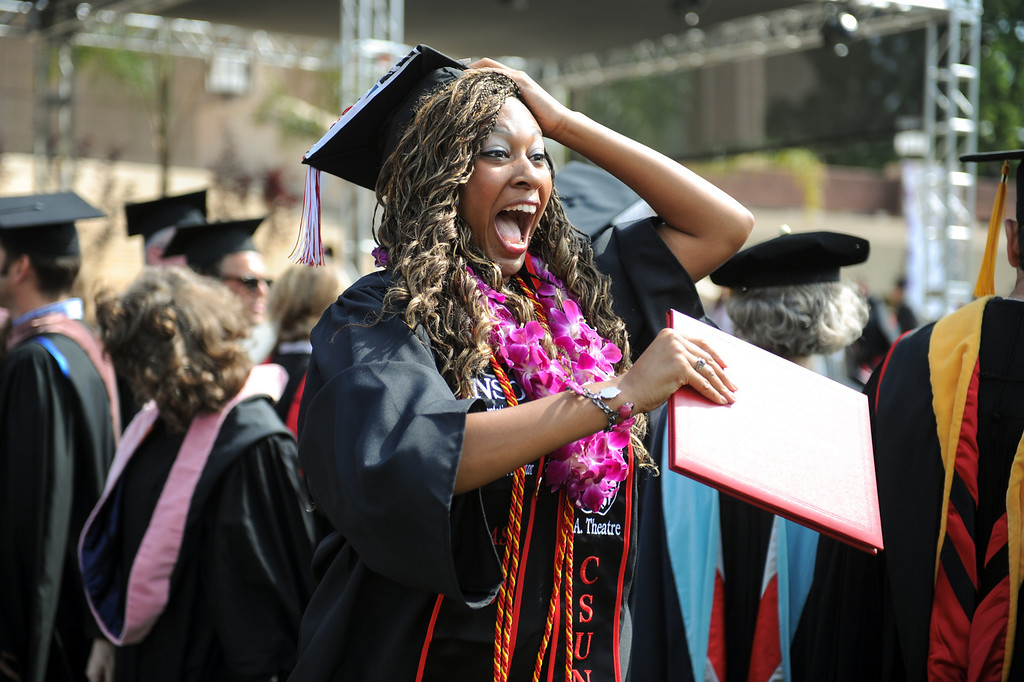 . Theatre arts major Monique Scott gets excited at the CSUN the commencement ceremony, Tuesday, May 21, 2013. (Michael Owen Baker/L.A. Daily News)