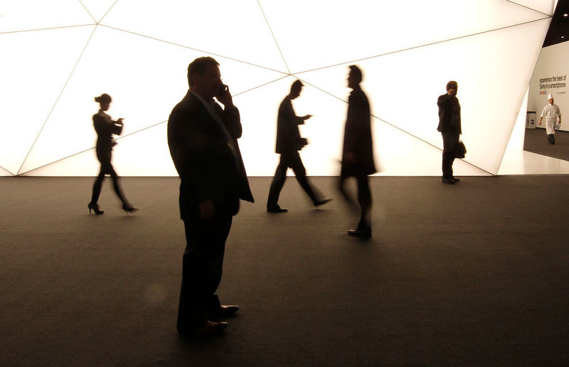 . Visitors walk during the the Mobile World Congress in Barcelona on February 26, 2013. The GSMA Mobile World Congress, representing the interests of the worldwide mobile communications industry, takes place from February 25 to 28 in Barcelona. REUTERS/Gustau Nacarino