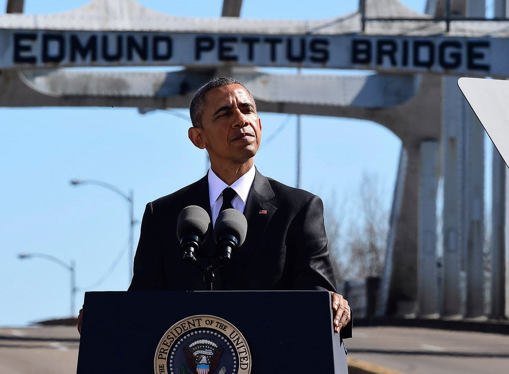 ". President Barack Obama speaks near the Edmund Pettus Bridge, Saturday, March 7, 2015, in Selma, Ala. This weekend marks the 50th anniversary of ""Bloody Sunday,\"" a civil rights march in which protestors were beaten, trampled and tear-gassed by police at the Edmund Pettus Bridge, in Selma. (AP Photo/Bill Frakes)"