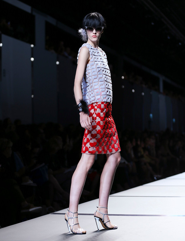 . A model wears a creation for Fendi  women\'s Spring-Summer 2014 collection, part of the Milan Fashion Week, unveiled in Milan, Italy, Thursday, Sept. 19, 2013. (AP Photo/Antonio Calanni)