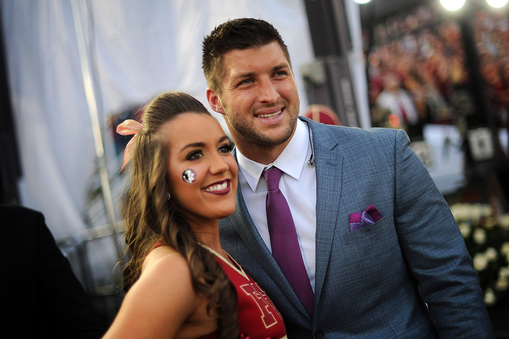 . Tim Tebow poses for a photo with Florida State cheerleader Taylor Rone prior to the start of the 2014 Vizio BCS National Championship January 6, 2014 in Pasadena CA.(Andy Holzman/Los Angeles Daily News)