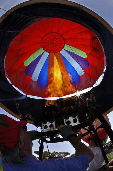 Title 20100918142554 * Price Level C * Hot air balloon pilot inflating his envelop