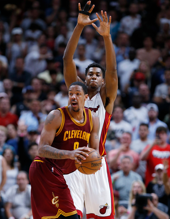 . Cleveland Cavaliers forward Channing Frye looks for an open teammate past Miami Heat center Hassan Whiteside during the final seconds of an overtime period in an NBA basketball game, Monday, April 10, 2017, in Miami. The Heat defeated the Cavaliers 124-121 in overtime. (AP Photo/Wilfredo Lee)