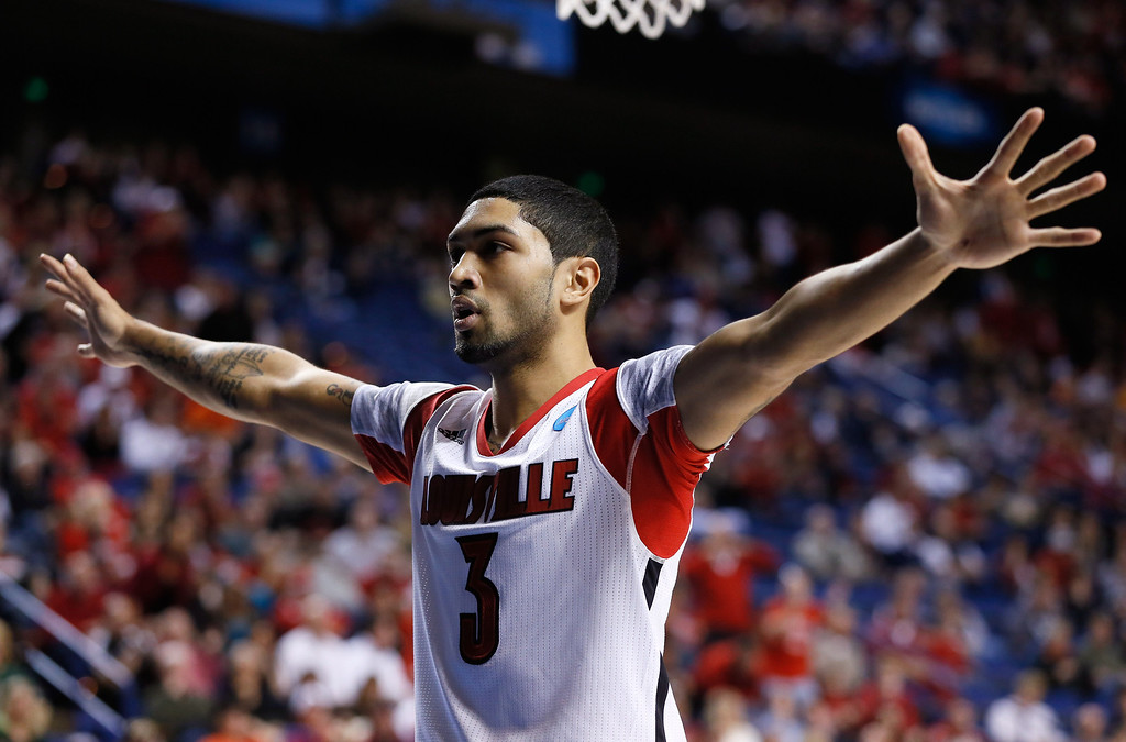 . LEXINGTON, KY - MARCH 23: Peyton Siva #3 of the Louisville Cardinals defends against the Colorado State Rams in the first half during the third round of the 2013 NCAA Men\'s Basketball Tournament at Rupp Arena on March 23, 2013 in Lexington, Kentucky.  (Photo by Kevin C. Cox/Getty Images)