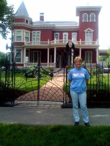 Sharon in front of Stephen King's house.JPG