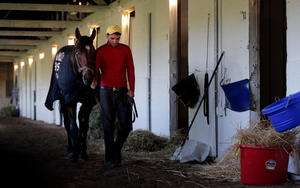 . Kentucky Derby entrant Uncle Sigh is walked after a morning workout during a morning workout at Churchill Downs Friday, May 2, 2014, in Louisville, Ky. (AP Photo/Charlie Riedel)