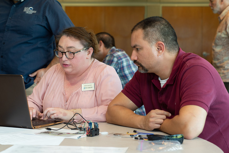Sylvia Sanchez (left) and Marco Longoria at the Microcontrollers Workshop at the Harte Research Institute.