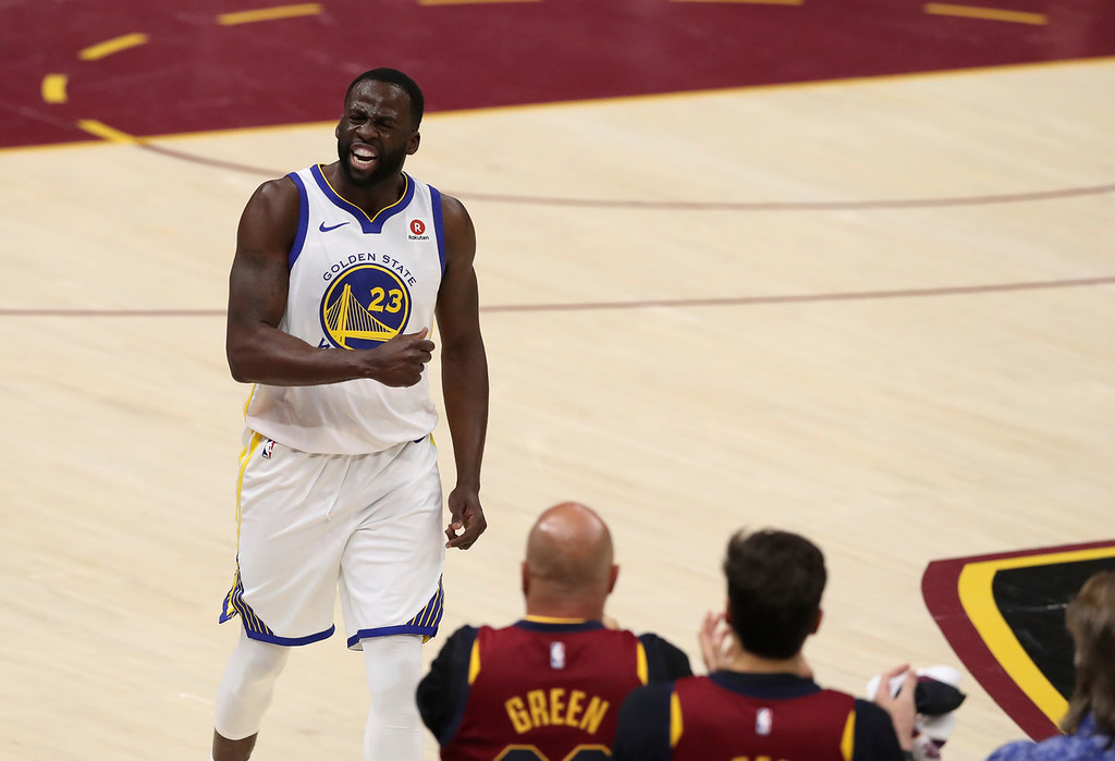 . Golden State Warriors\' Draymond Green reacts during the first half against the Cleveland Cavaliers in Game 3 of basketball\'s NBA Finals, Wednesday, June 6, 2018, in Cleveland. (AP Photo/Carlos Osorio)
